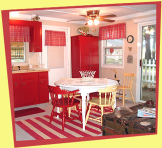 This cozy cottage was in need of an updated décor on a shoestring budget. Painting the old cupboards a cranberry red breathed new life into the kitchen and supplied a wonderful color pallet to work from throughout the cottage.